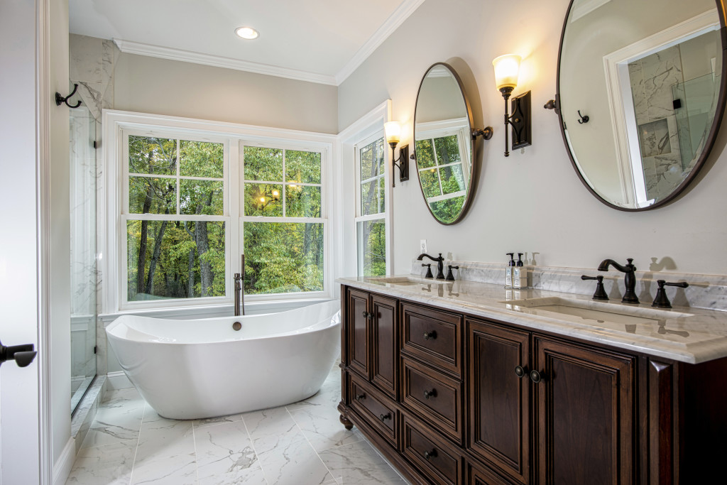 Master Bath with Soaking Tub, Views of Woods Beyond and Fitted Furniture Vanity